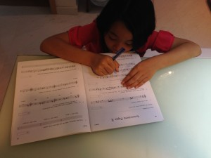 Girl Studying Hard for Her Upcoming Music Theory Exam